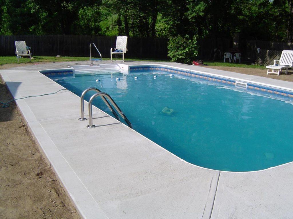 Pool concrete company pool decking concrete contractor for Concrete pool